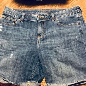 Lots of women's tops, shorts, denim